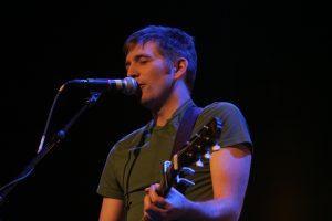 John K. Samson performs live at The Burton Cummings Theatre in Winnipeg, 2007. Wikimedia Commons.